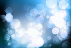 Abstrakt suddig blå bokehbakgrund, vitcirklar Royaltyfri Bild