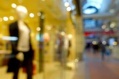 Abstrakt suddig bokehbakgrund av shoppinggallerian Royaltyfri Fotografi