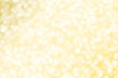 Abstrakt suddig för fyrkantbokeh för gul guld bakgrund Arkivfoton