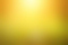 Abstrakt suddig gul bakgrund Fotografering för Bildbyråer