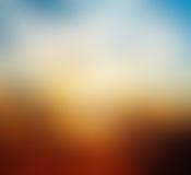 Abstrakt suddig härlig solnedgång i aftonen Arkivfoto