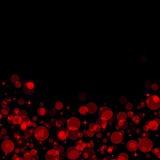 Abstrakt svart bakgrund med röda bokehcirklar Royaltyfri Bild