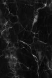 Abstrakt svart marmor mönstrad texturbakgrund (för naturliga modeller) royaltyfri bild