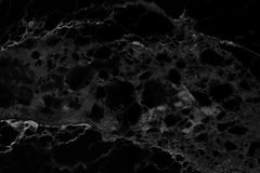 Abstrakt svart marmorbakgrund med naturliga motiv arkivbild