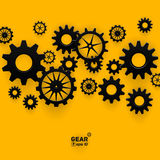 Abstrakt svart symbol för kugghjulhjul på ljus guling Arkivfoto