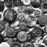 Abstrakt svartvit bakgrund av knappar Arkivbilder