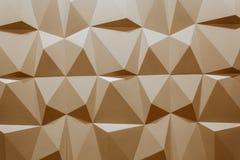 Abstrakt tapet eller geometrisk bakgrund som består av varma eller orange geometriska former: trianglar och polygoner Royaltyfri Fotografi