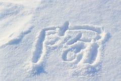 Abstrakt teckning på snö på en solig vinterdag Royaltyfria Bilder