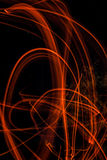 Abstrakt teckning som flammar slinganattkapacitet med en Ursa Major konstellation på bakgrunden Arkivbild