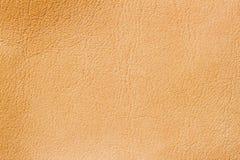 Abstrakt textur av äktt läder, ljus persikafärg, för märkes- bakgrund, bakgrund, substrate, sammansättningsbruk Arkivfoto