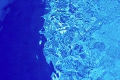 Abstrakt textur av briljant vattenblåttfärg Arkivfoton