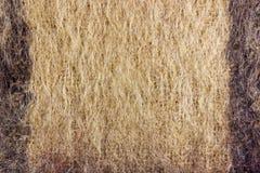Abstrakt textur av brunt stucken ull med svarta band Bakgrund av naturlig ull Royaltyfri Fotografi