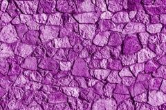 Abstrakt textur av en violett färg för stenyttersida Arkivbilder