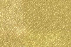 Abstrakt textur av en yttersida av guling-guld färg Arkivbild