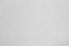 Abstrakt textur av färg för ark för vinyl papper perforerad vit Royaltyfria Foton