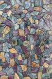 Abstrakt textur av stenmurverket färgade stenen. Stenvägg. Arkivbilder