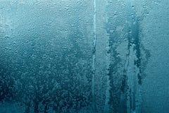 Abstrakt textur av våt glass blå grön färg Arkivbilder