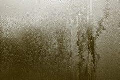 Abstrakt textur av våt glass kakifärg Arkivbilder