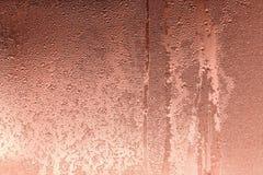 Abstrakt textur av våt glass kopparfärg Arkivbild