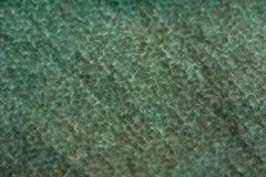 Abstrakt textur av vått material för gräsplan Fotografering för Bildbyråer
