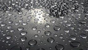 Abstrakt textur av vattendroppe på tabellen efter regn arkivbild