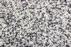 Abstrakt textur av woolen tyg med svartvita prickar Bakgrund för naturligt tyg Royaltyfri Bild