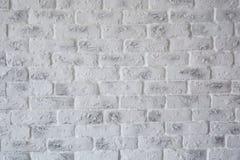 Abstrakt textur befläckt gammalt ljus - gråna och en vit bakgrund för tegelstenvägg i lantligt rum, grungy rostiga kvarter, arkit Arkivfoton