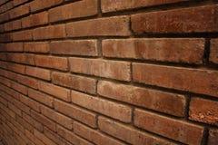 Abstrakt textur eller modellen av förvrider den bruna tegelstenväggen Arkivfoton