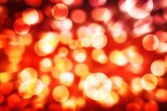 Abstrakt textur för bakgrund för Bokeh röd-brand ljus Arkivbild