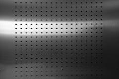 Abstrakt textur för stålplatta med perforerat användbart för backgrou Arkivbilder