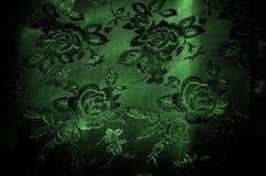 abstrakt textur för tyg för bakgrundsclosedesign upp rengöringsduk grönt silkeslent tyg med en modell av blommor PR Royaltyfria Bilder