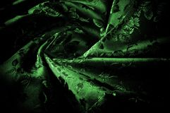 abstrakt textur för tyg för bakgrundsclosedesign upp rengöringsduk grönt silkeslent tyg med en modell av blommor PR Arkivbilder