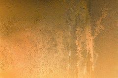 Abstrakt textur fryste vattendroppar av guld- färg Arkivbild