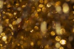 Abstrakt textur med guld blänker att skimra i solen lampa Royaltyfria Bilder