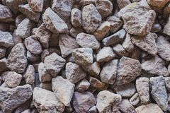 Abstrakt texturbakgrund med stenar Yttersida med ett stort antal stenar Royaltyfri Foto
