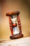 Abstrakt timglas på trä Fotografering för Bildbyråer