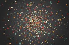 Abstrakt tolkning av kulöra kaotiska partiklar Arkivbilder