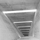 Abstrakt tom bakgrund för inre för grå färgbetongtunnel Fotografering för Bildbyråer