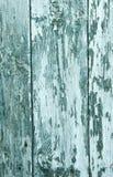 Abstrakt träbakgrund med sprickor på den blåa målarfärgmurbruken Arkivbild