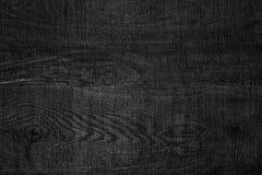 Abstrakt trämörker - grå texturbakgrund Arkivbild