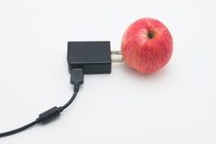 Abstrakt uppladdare med äpplet Arkivbild
