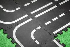 Abstrakt vägbakgrund - lekplatsen mattar Royaltyfri Fotografi