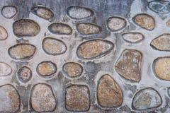 abstrakt vägg för textur för sten för bakgrundsmodellfoto Fragment av en vägg från en kanstött sten Fotografering för Bildbyråer