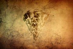 Abstrakt vänt om konstnärligt vaggar den formade pyramiden på en färgrik texturbakgrund för tappning arkivfoto