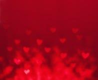 Abstrakt valentin dagbakgrund med röda hjärtor Glöd Colorf Royaltyfria Bilder