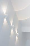 Abstrakt varmt ljus på väggen Arkivfoto
