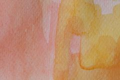 Abstrakt vattenfärghand som målas i rött, apelsin och guling Flerfärgad vattenfärgtextur och bakgrund för design royaltyfria foton