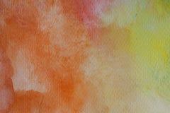 Abstrakt vattenfärghand som målas i rött, apelsin och guling Flerfärgad vattenfärgtextur och bakgrund för design Arkivbild