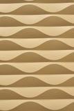 Abstrakt vertikal bakgrund för guld- vågor Arkivfoton