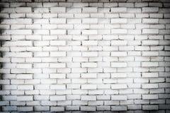 Abstrakt vit bakgrund för tegelstenvägg i lantligt rum, grungy rostiga kvarter av stenhuggeriarbetearkitekturtapeten arkivfoto